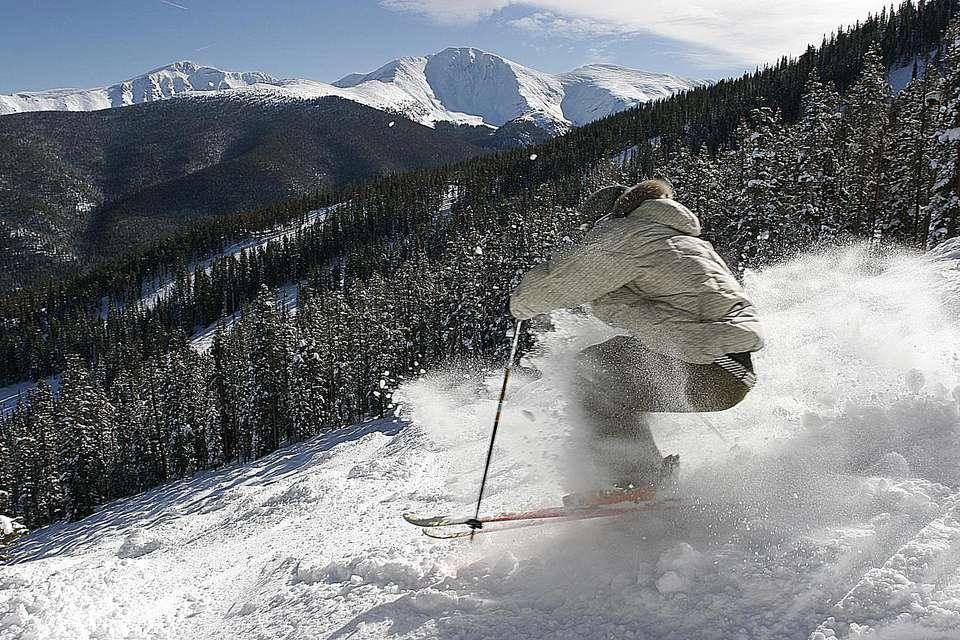 Expert skier enjoys powder Winter Park, Colorado