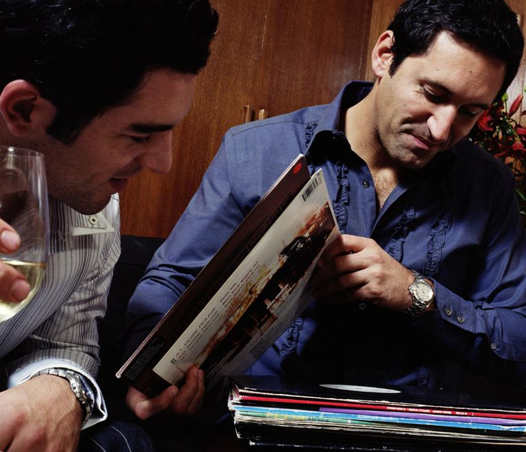 Two men looking through records