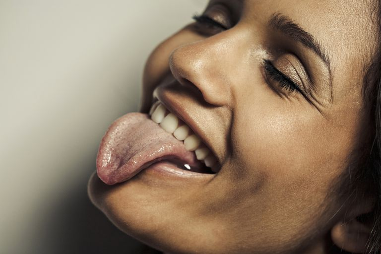 woman sticking out her tongue