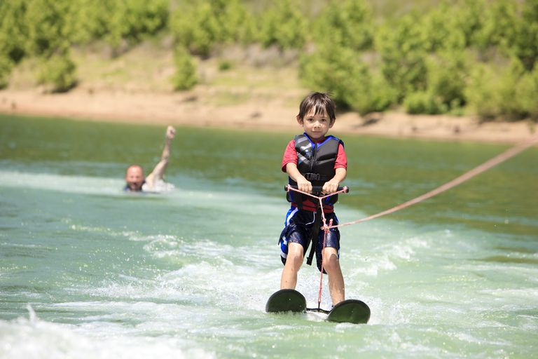 Young boy waterskiing