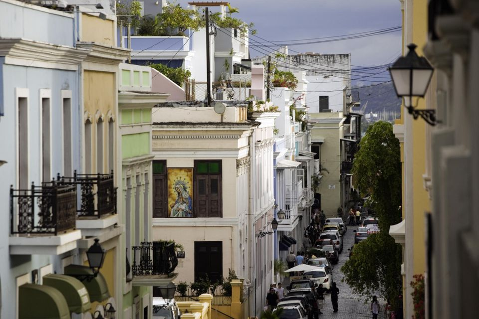 View looking down street with multi-colored buildings, Old San Juan, Puerto Rico
