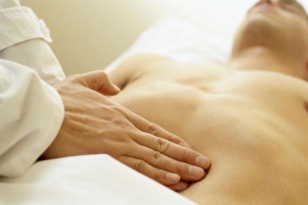 Massage Therapist Palpating the Abdomen