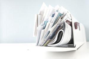 A mailbox stuffed full of junk mail