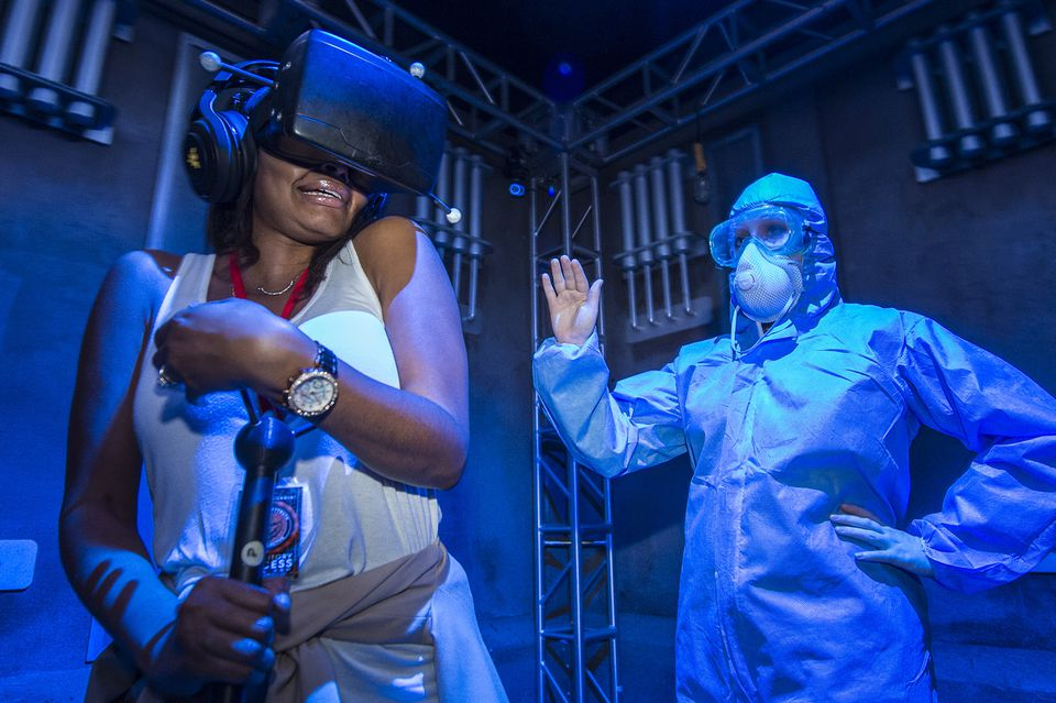 Guest reacting to an interactive experience called The Repository at Universal Orlando's Halloween Horror Nights.