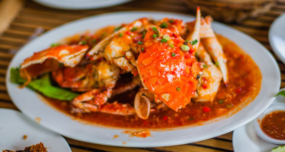 Close-Up Of Crab Gravy Served On Table