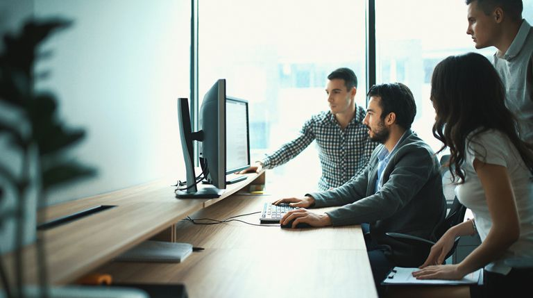 Group of IT experts in their office.