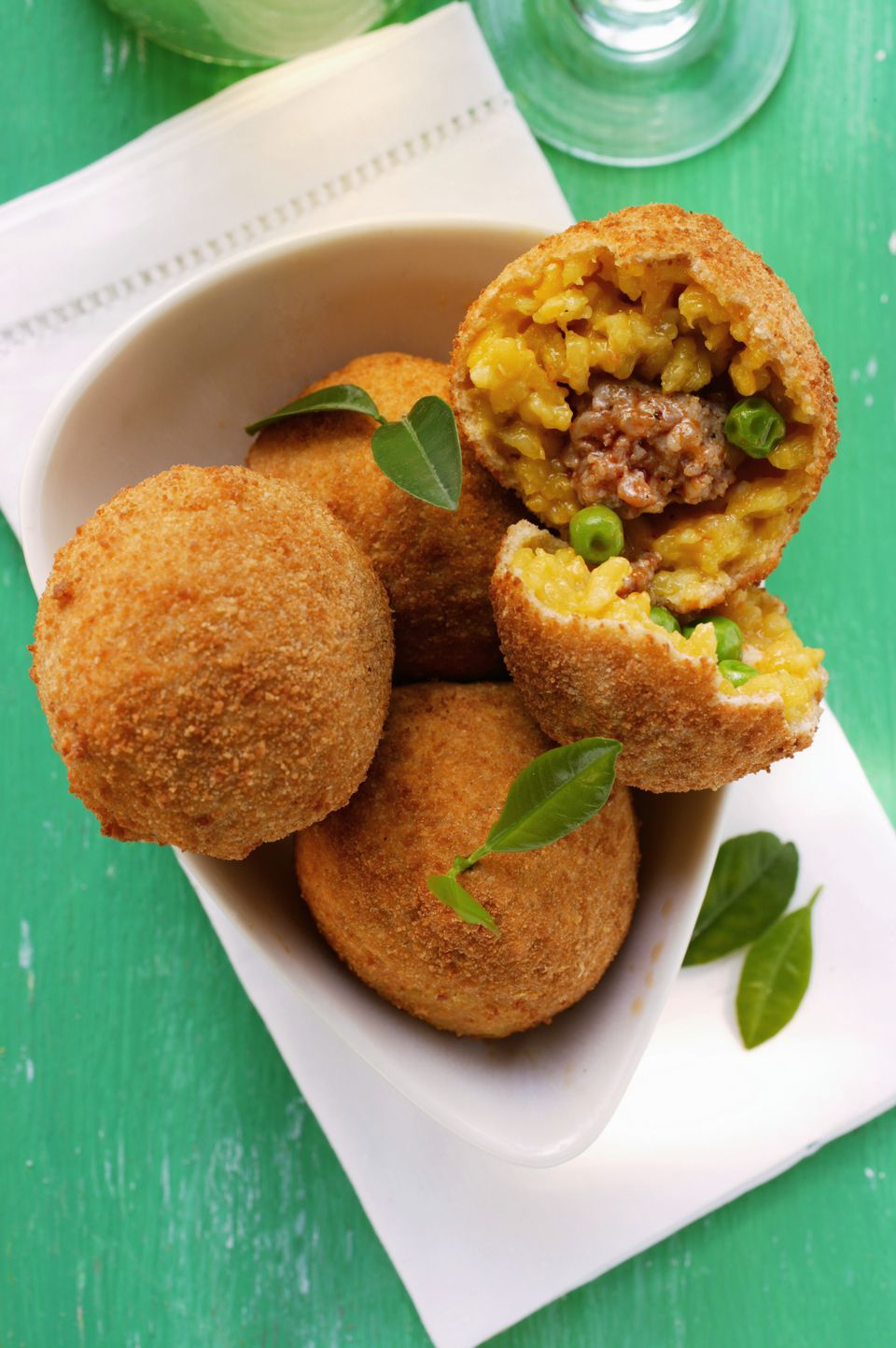 Arancini, Sicilian Rice Balls Stuffed with Meat Sauce and Peas