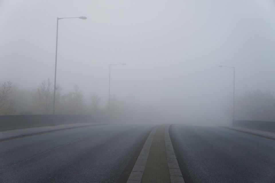 Road with thick fog