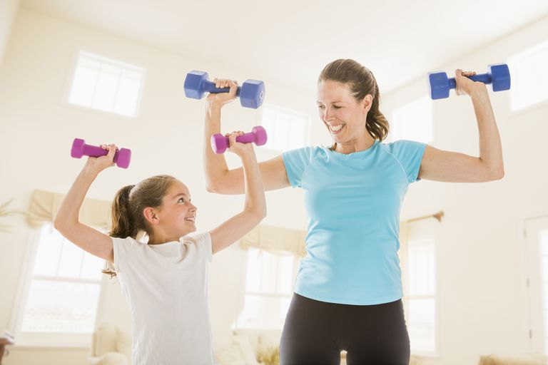 mother and daughter lifting weights