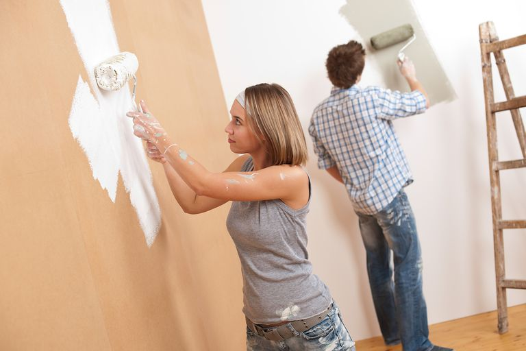 young couple painting walls