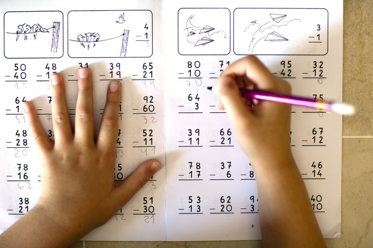 Child's hand while doing the homework