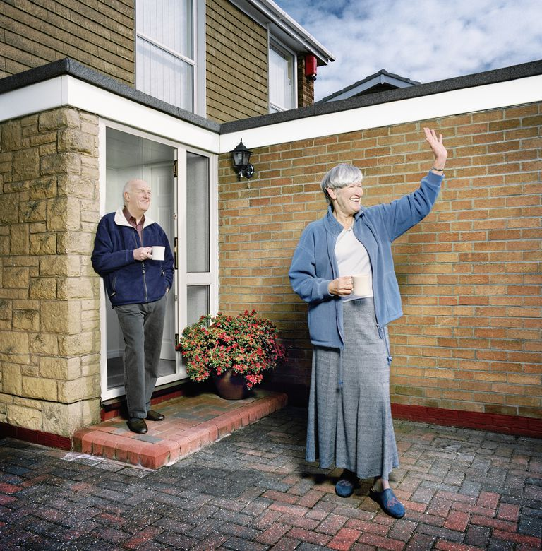 Older couple in front of home