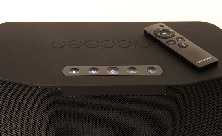 The top of the Peachtree Audio Deepblue2 Bluetooth speaker, showing buttons and remote control