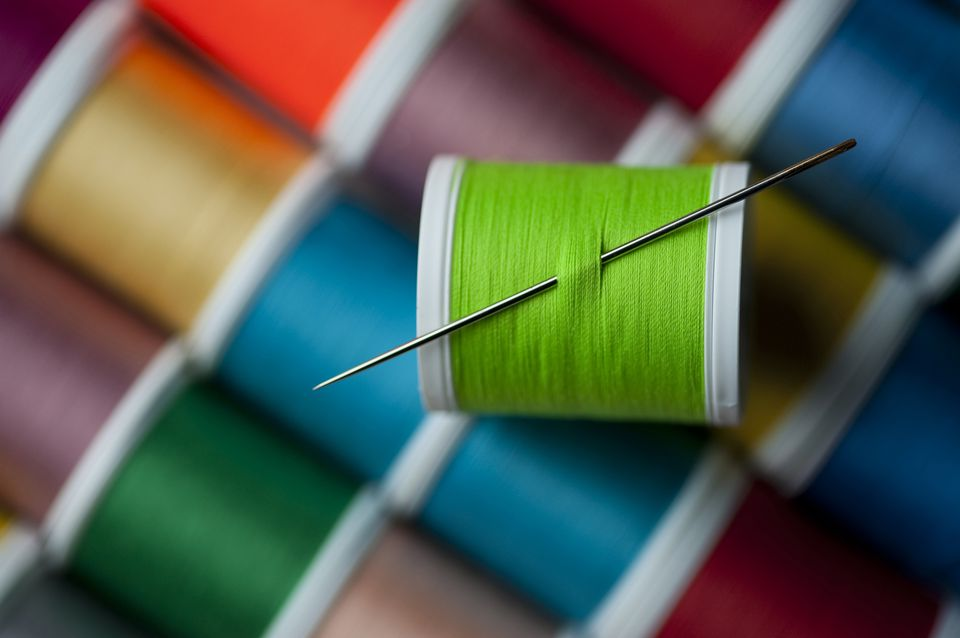 sewing needle and colored threads
