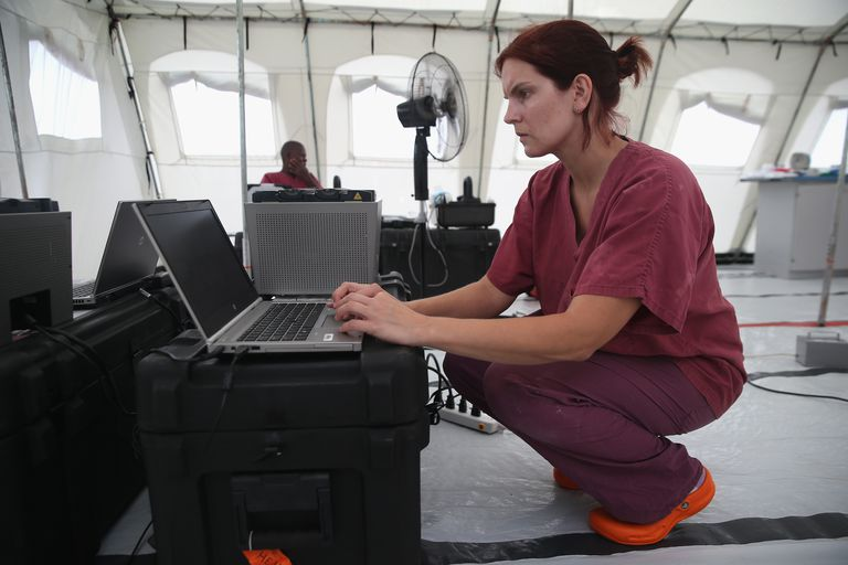A scientist working at the CDC mobile Ebola lab in Liberia.