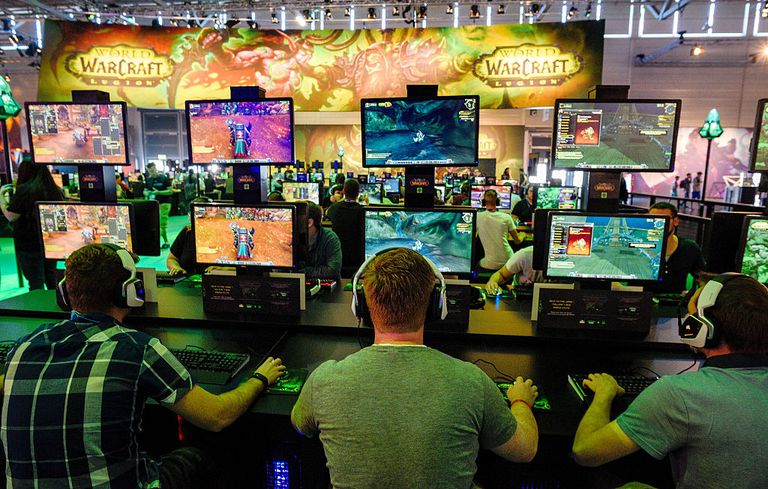 Men playing World of Warcraft at an event
