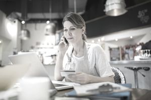 Business owner ordering at her laptop