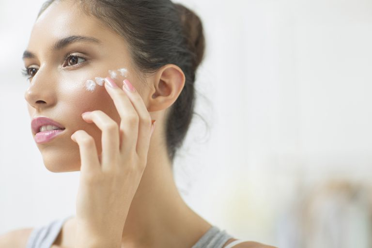 Woman applying face cream