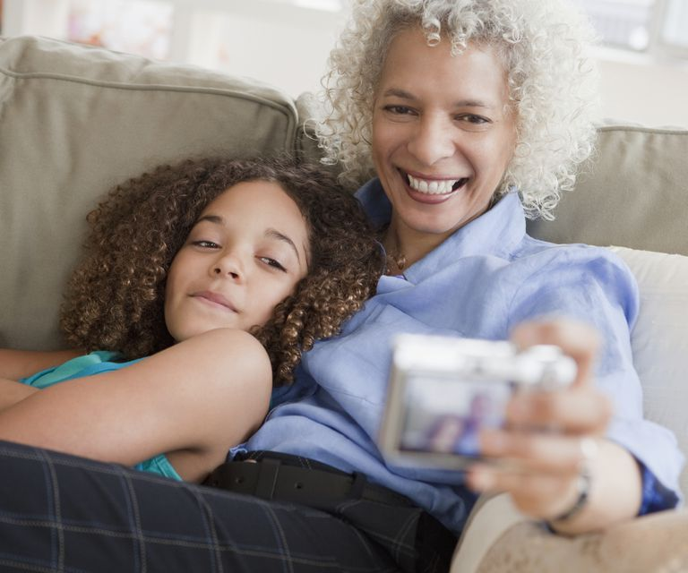 tween granddaughter with her grandmother taking a photo