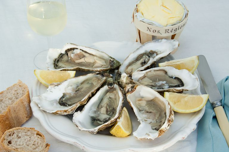 Oysters in shells with lemon