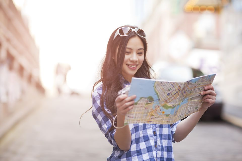 Traveler looking at a map