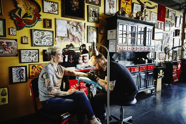 Woman Getting a Tattoo