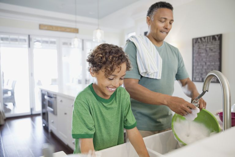 9 year old child development - father and son doing dishes