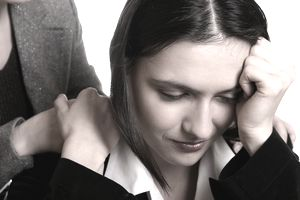 Woman crying and being comforted