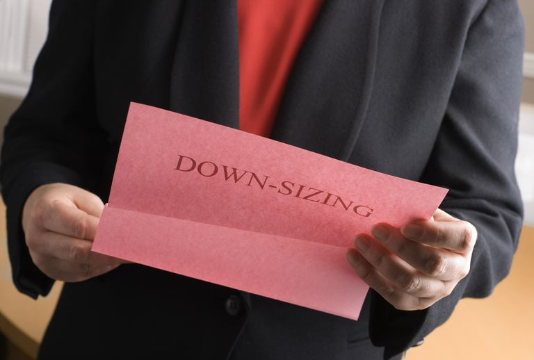 business man holding paper that says