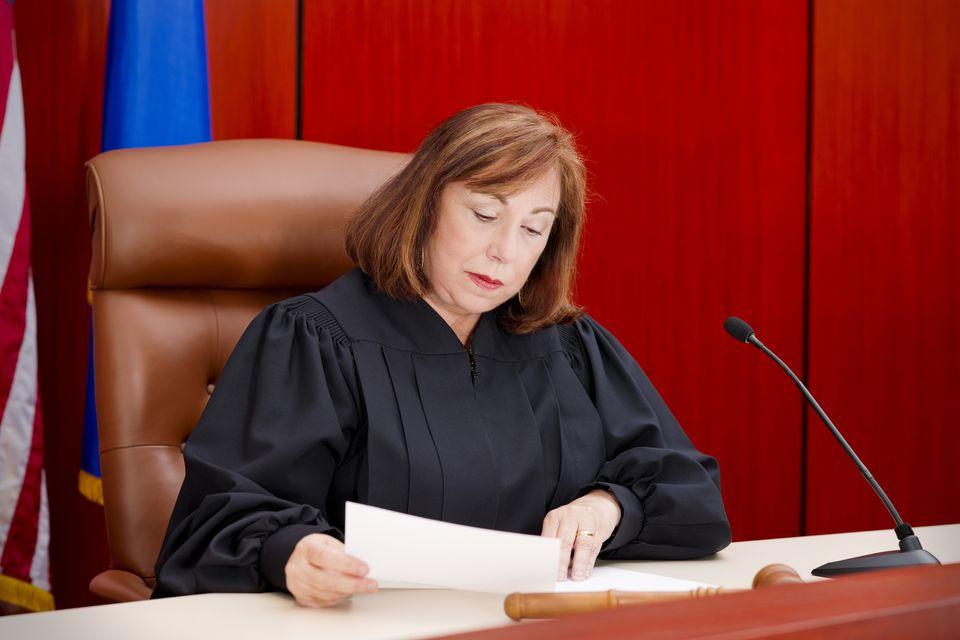 Senior female judge at the bench reading paper