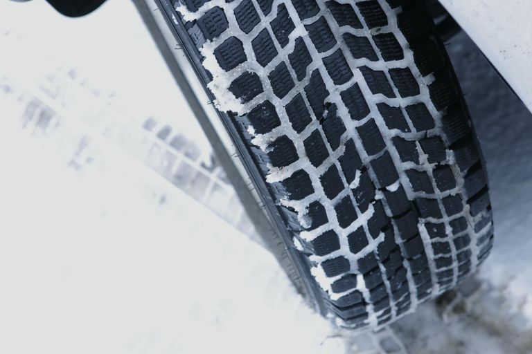 Tire on snowy road, close up