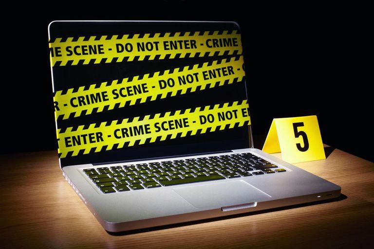 Laptop wrapped in crime scene tape