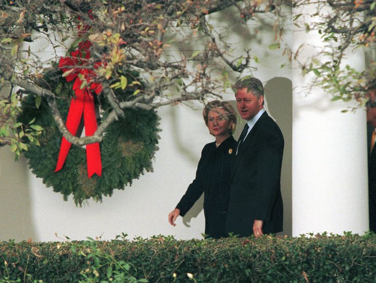 President Clinton and Hillary Clinton in front of White House Christmas Wreath