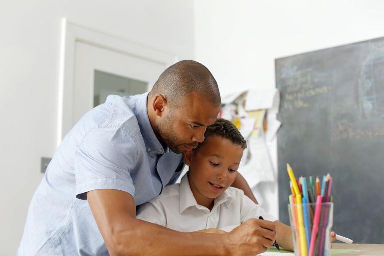 Father helping son homeschool / Reasons not to homeschool