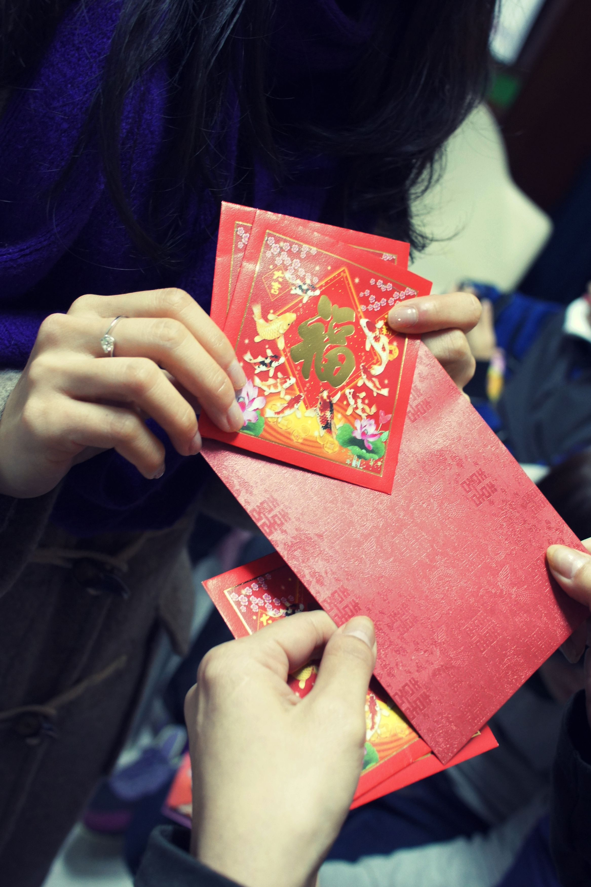 Giving Hong Bao Red Envelopes At Chinese New Year