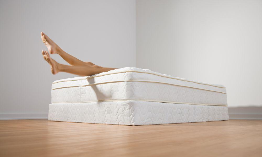 Mattress with a women's legs.
