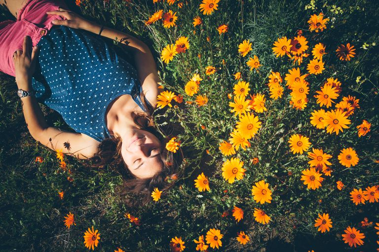 Woman lying in flower patch