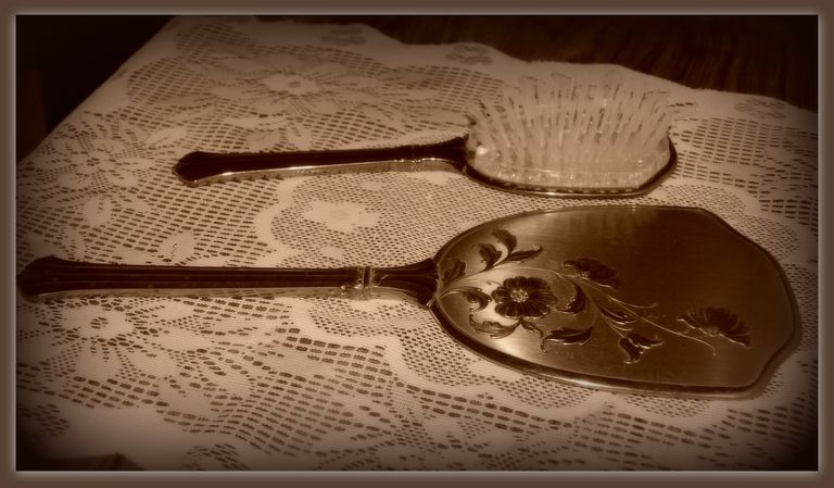 Antique silver brush and mirror.