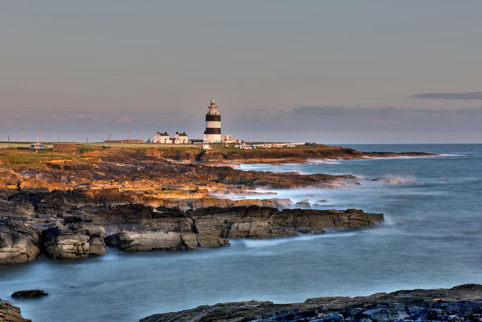Hook Head lighthouse and cliff of Wexford County Ireland