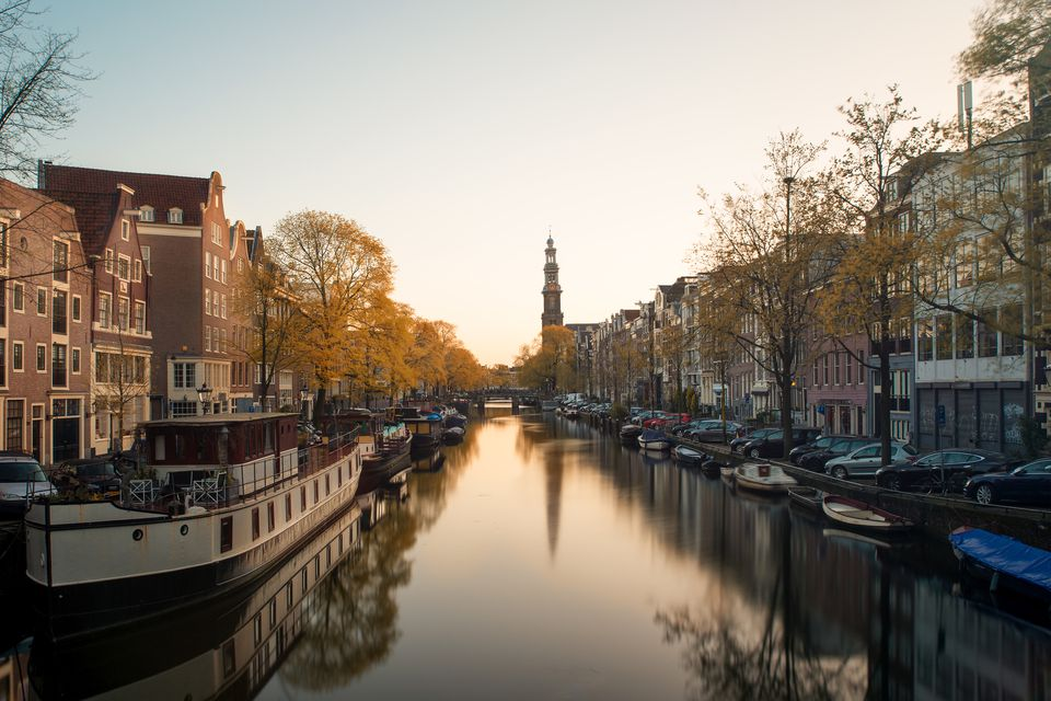 Westerkerk church and canal at morning in Amsterdam, Netherlands.Beautiful autumn season in Amsterdam, Netherlands.