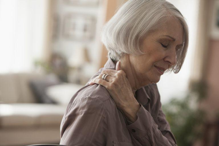 Senior Caucasian woman rubbing her shoulder