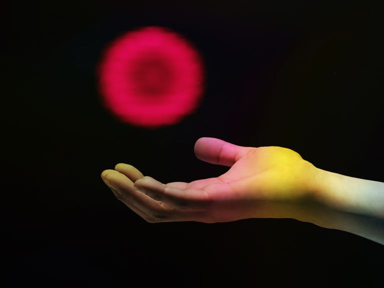 Ball of Energy Floating in Palm of Hand