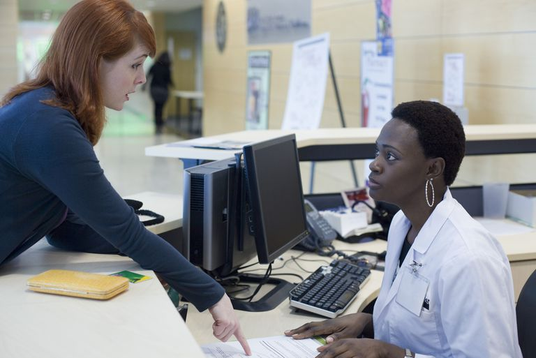 Upset patient explaining medical problem to receptionist