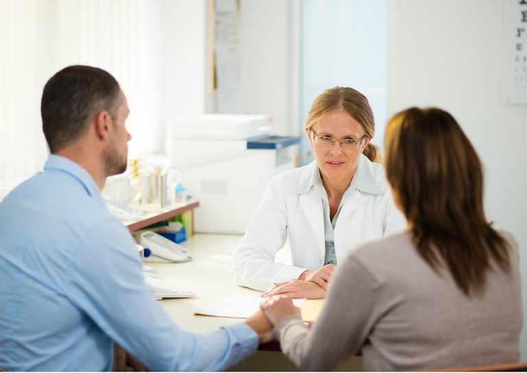 Couple talking with therapist about how he can best support his wife with PCOS