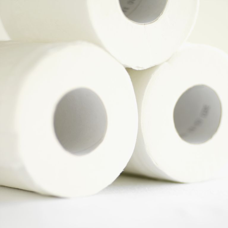 Close-up of three rolls of toilet paper