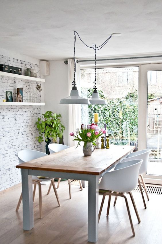 Kitchen with Scandinavian lighting, chairs and design style