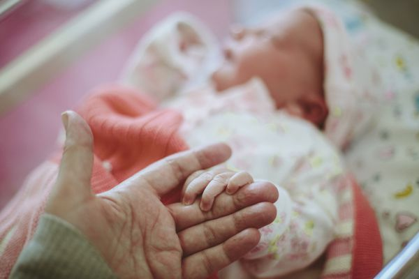 Newborn baby holding Mothers hand