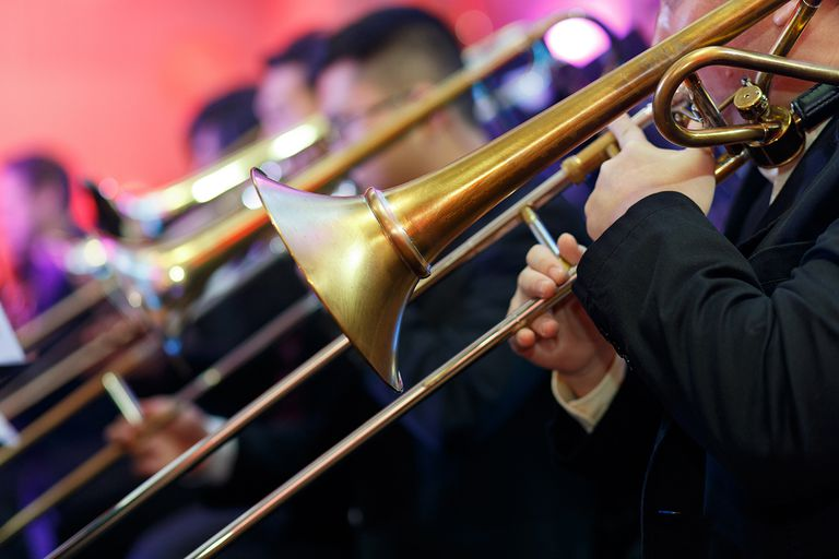 Men Playing Trombone At Event