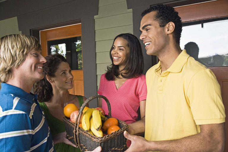 Friendly neighbors giving fruit basket