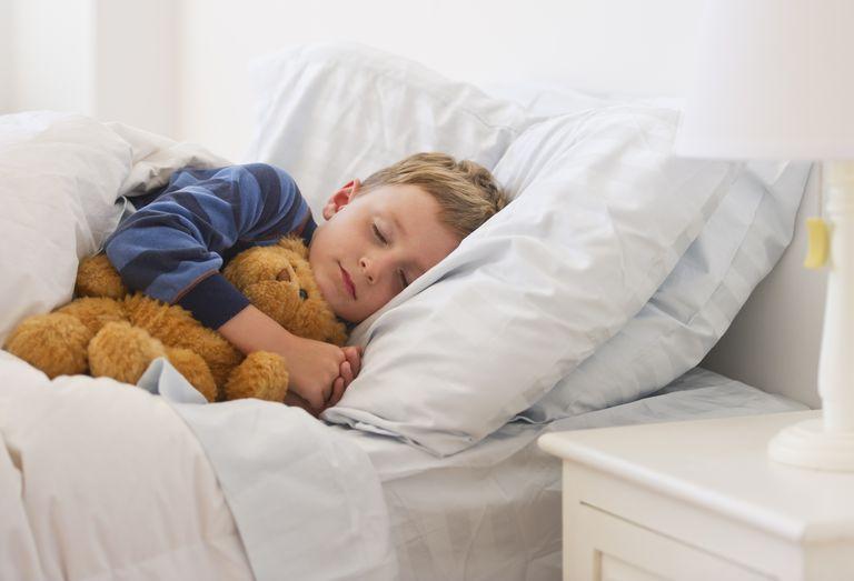 boy sleeping in bed - kids sleep problems